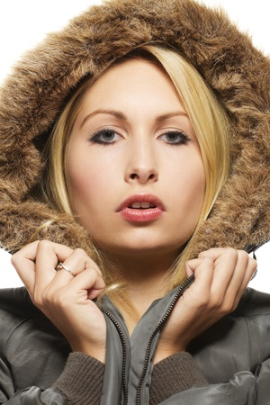 beautiful blonde woman wearing a parka with fur on white background photo