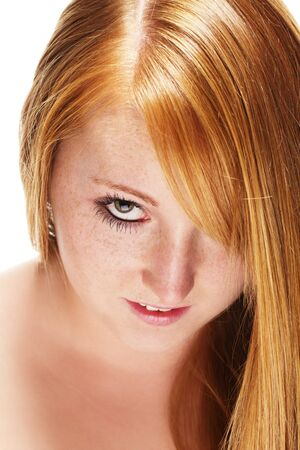 freckled: portrait of a redhead girl with beautiful hair on white background Stock Photo