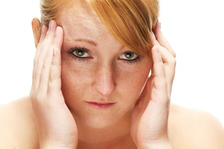 young redhead woman suffering on headache on white background photo