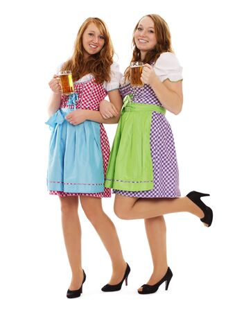 two bavarian women with beer on white background photo