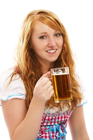 pretty bavarian girl with a glass of beer on white background photo