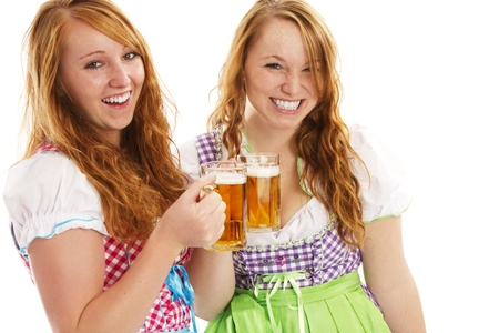 two happy bavarian girls with beer on white background photo