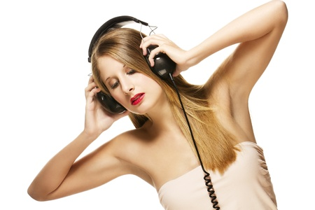 beautiful woman with headphones listening to music on white background photo