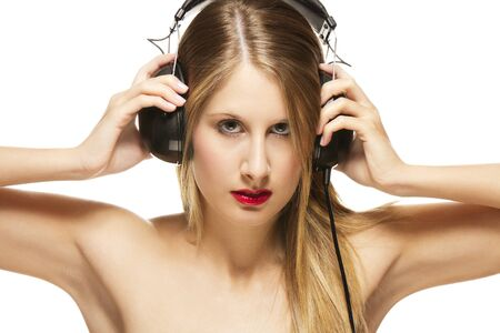 beautiful woman with headphones spreading her arms on white background photo