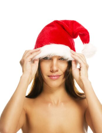 beautiful brunette woman put on santas hat on white background Stock Photo - 11395679