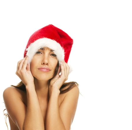 comically: young woman wearing santas hat making faces on white background