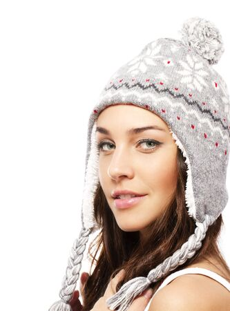 lifestyle looking lovely: smiling young woman wearing winter cap on white background