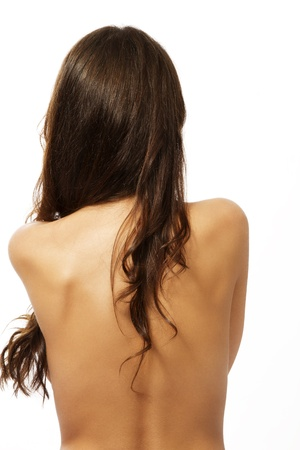naked back of a brunette woman on white background photo