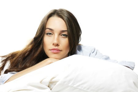portrait of a beautiful woman in bed on white background photo