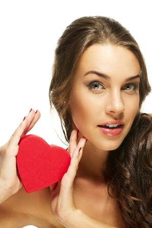 beautiful woman presenting red heart on white background Stock Photo - 11975521