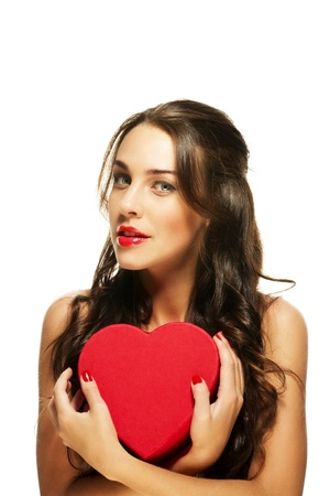 beautiful woman with red lipstick holding red heart on white background photo