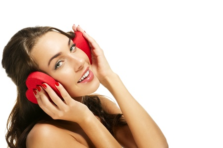 happy woman holding red heart shaped box on her ears on white background photo
