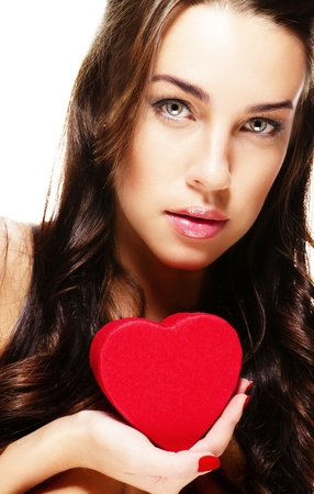 cute brunette woman holding red heart on white background photo