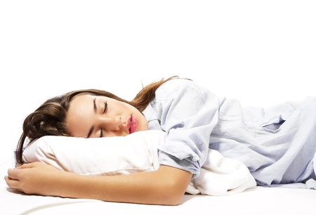 beautiful sleeping woman in pajamas on white background Stockfoto