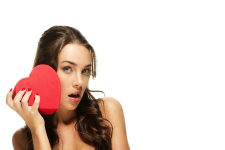 beautiful surprised woman with a red heart on white background Stock Photo - 11973128