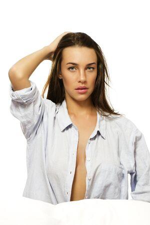 beautiful woman with open pajamas on white background Stock Photo - 11975513