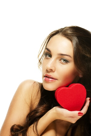 beautiful woman holding small red heart on white background