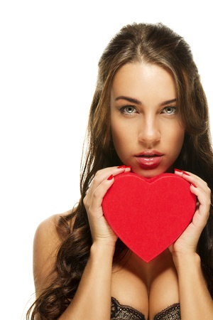 gorgeous brunette woman holding red heart on white background photo