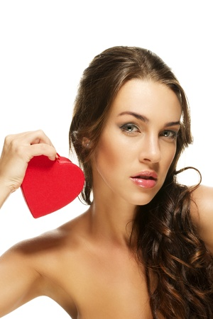 gorgeous woman holding red heart on white background photo