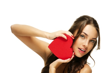 amazing beautiful woman holding red heart on white background photo
