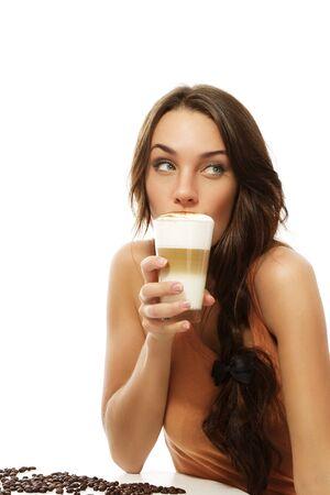latte macchiato: beautiful woman drinking latte macchiato coffee looking to side on white background