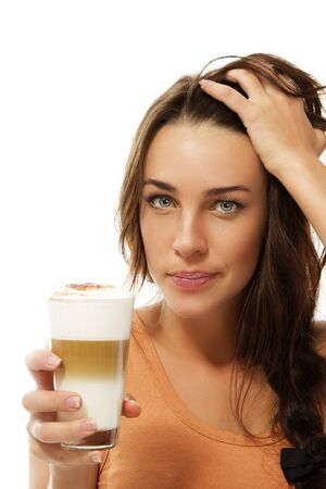 latte macchiato: cute young woman holding her hair with latte macchiato coffee in her hand on white background