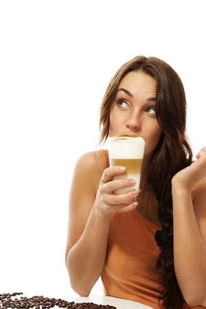 young woman drinking latte macchiato coffee looking up on white background Stock Photo - 12630197