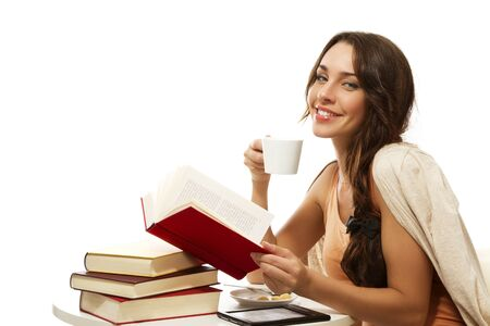 the reader: happy woman with books, coffee and ebook on white background