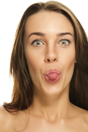 beautiful woman poking tongue out on white background photo