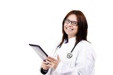 happy female doctor with a tablet pc on white background photo