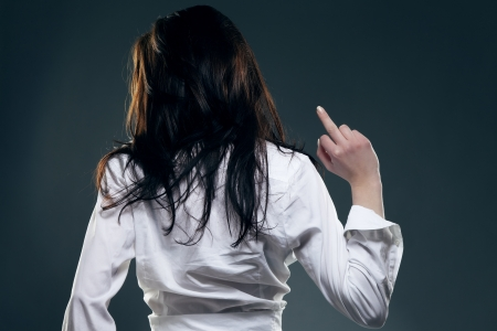 young woman from back showing the middle finger