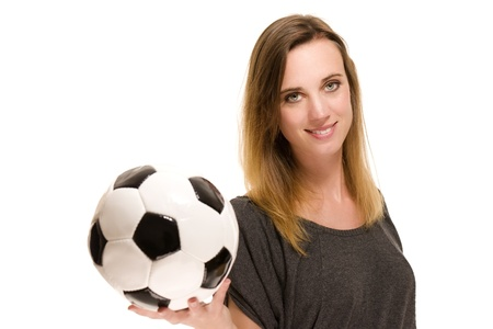 soccer wm: portrait of a woman holding a soccer ball on white background Stock Photo