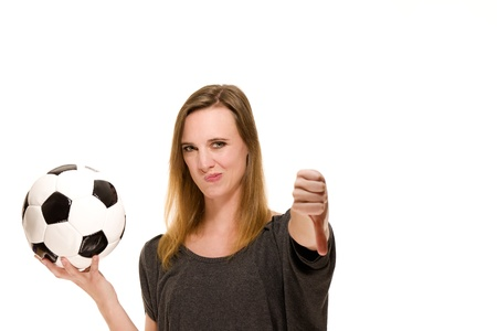 woman holding a soccer ball showing thumbs down on white background Stock Photo - 13823863