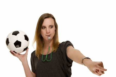 soccer wm: woman with a whistle holding a football pointing at something on white background