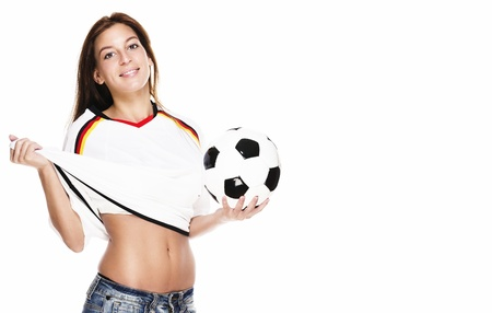 beautiful woman holding football pulling her football shirt on white background photo