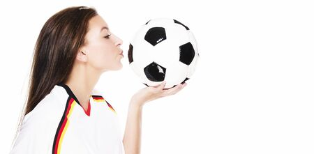 soccer wm: beautiful young woman kissing a football on white background Stock Photo