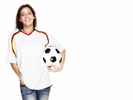happy woman wearing football shirt holding football on white background photo