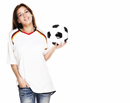soccer wm: smiling woman wearing football shirt presenting a football on white background