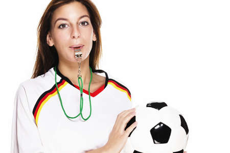 soccer wm: beautiful woman with a whistle wearing football shirt holding football on white background Stock Photo