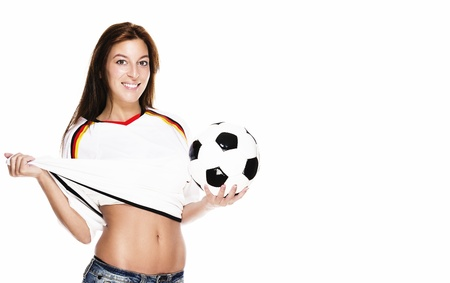 soccer wm: happy woman presenting football pulling her football shirt on white background