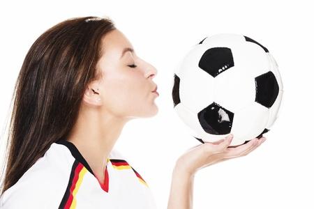 soccer wm: joven y bella mujer a punto de besar a una pelota de f�tbol sobre fondo blanco Foto de archivo