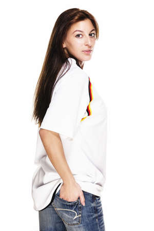 soccer wm: young woman wearing blue jeans and football shirt turning around on white background