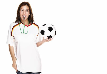 soccer wm: beautiful woman with a whistle wearing football shirt and holding football on white background