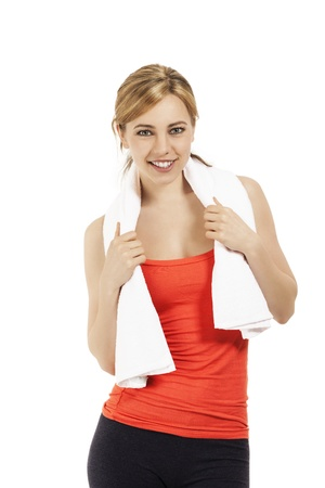young sporty fitness woman with a towel on white background photo