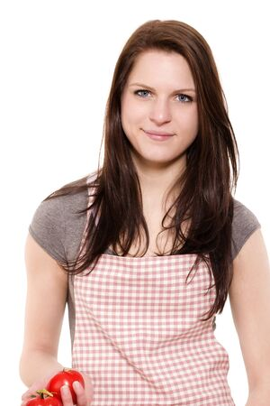 portrait of a smiling young woman with red apron holding tomatoes on white background Stock Photo - 14031361