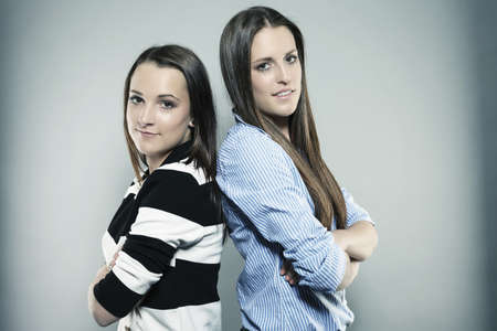 two teenagers with folded arms Stock Photo - 14180040
