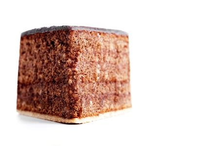 piece of a chocolate cake from front on white background photo