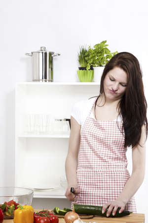 young woman is not happy about the working in her kitchen photo