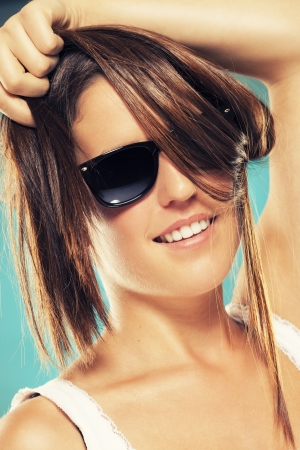 smiling teenager wearing black sunglasses photo