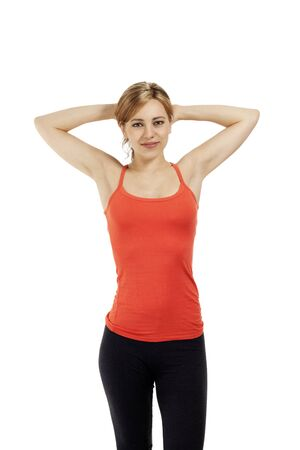 young fitness woman holding her arms over her head on white background photo
